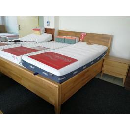 Masívna dubová manželská posteľ Lozzane s úložným priestorom a celodreveným čelom